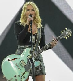 Miranda Lambert rocking out on the first night of the #spreadthelovetour with Kenny Chesney