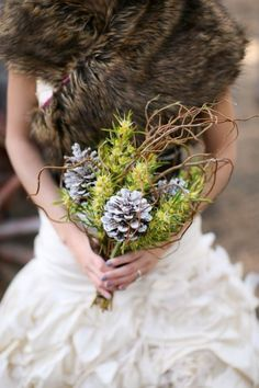 A perfect winter wedding bouquet alternative to traditional roses and other winter flowers. The winter wedding theme is alive and well with the use of frosted pine cones and winter greens for a pop of color. Winter Bridal Bouquets, Winter Bouquet, Winter Wedding Flowers, Fall Bouquets, Flower Bouquet Wedding, Bouquet Flowers, Winter Weddings, Viking Wedding, Rustic Wedding