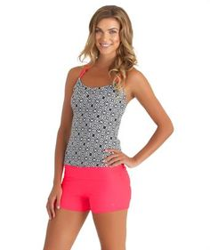 Get your hands on the @nextswimwear by Athena Inner Chakra Shirred Tankini Top and and Good Karma Roll Top Swim Short. This tankini top will keep you cool at the beach or the gym with its moisture wicking fabric. $126 Swimspot.com #swimwear #activewear