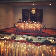 lights under 'khaki' linens made such a warmer feel versus white -- love for head table