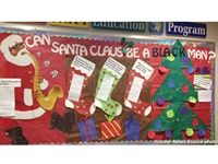 "BLOOMINGTON, Indiana - According to a university spokesman, it was created as part of a diversity program designed to ""raise awareness and promote discussion on issues such as race, gender and sexual identity."" The controversial  display  was posted on a bulletin board for the Community Education Program in Foster Residence Center, and poses the question ""Can Santa Claus be a black man?"" The university has since taken it down after the display sparked outrage on social media."