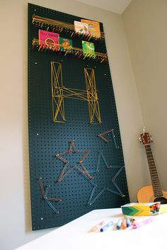 peg board string/rubberband art - fine motor, visual motor, and if hung on the wall, shoulder strength/ROM and trunk strength/control
