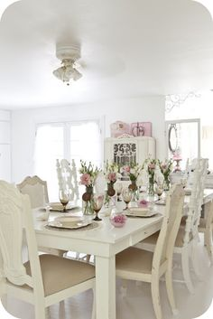 White dining room with pink accents.