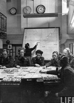 British plotting room, 1943.Women were an integral part of the British war effort, serving in significant numbers with the RAF as Women's Auxilliary Air Force in radar operations.  Women served with the RCAF as well, but as Canada was not as mobilised as Britain, their service was less widespread.  That said, the British model of radar operations was used for the manning of the Pine Tree Line, which was established in the early '50s, with women serving in at PTL bases across Can
