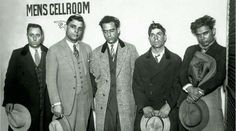 1920's Chicago gangsters await booking.