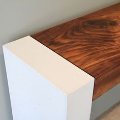 Contego Console Table by Steven Pollock.  A beautiful hardwood slab suspended between two pillars of silky fine white concrete.  Available at Kozai Modern  $3,900