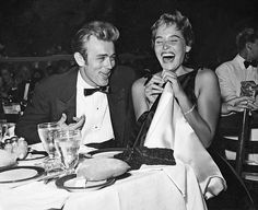 James Dean and Ursula Andress at an awards dinner.