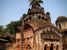 This temple at Bali-Dewangunj, District Hooghly, West Bengal has 2 unique features : (1) it is a Jorbangla temple with a Nabaratna pinnacle on top; & (2) It has the largest (possibly) terracotta Durga panel on front facade.