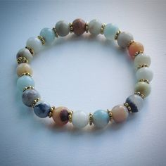 Elasticated beaded bracelet - Amazonite and gold spacer beads