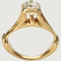 ROMAN OCTAHEDRAL DIAMOND RING. Roman Empire, second half of the 3rd century to early 4th century AD.Gold and diamond.  The high bezel of this ring is set with a natural octahedral diamond crystal weighing about 1.65 carats.