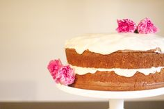 Naked cake with flowers - perfect for Valentine's Day. (Buttermilk pound cake with vanilla buttercream frosting).