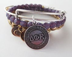 Delta Phi Epsilon, I want this! Already have the bracelet, but I want the other beads! It's super cute! Someone buy it for me!