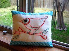 Cute embroidered bird pillow.