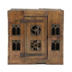 In the late 15th century Gothic manner of an aumbry/food hutch Having a boarded top and sides, the central door with two Gothic tracery apertures, flanked to either side by twin Gothic lancet pierced boards, traces of paint 70cm wide x 31cm deep x 69cm high, (27.5 wide x 12 deep x 27 high)