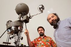 Two SDSU astronomers Jerome Orosz, left, and Bill Welsh, at right, in the schools planetarium. They helped NASA find two planets that are more like Earth the anything theyve ever seen. — Charlie Neuman