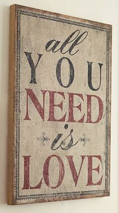 sweet 'all you need is love' sign http://rstyle.me/n/unh7ar9te