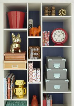 Whenever kids are involved, there are always random things like toys, books and gadgets  scattered around a family room. A white versatile, stackable shelving unit that holds decorative boxes, bins and baskets is a perfect solution for corralling these items.