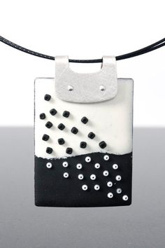 Cool matching pendant to go withe the earrings. Love the bail on this. Simple, riveted, and elegant.