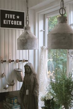 I like this picture: The statue, plant, wall, cafe curtains and light fixtures and hooks on the wall/what's hanging on the hooks. Vintage Light Fixtures, Vintage Lighting, Cool Lighting, Industrial Lighting, Industrial Chic, Lighting Ideas, Rustic Style, Farmhouse Style, French Farmhouse