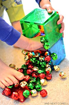 Christmas science for toddlers and preschoolers using Magna-Tiles and jingle bells from And Next Comes L