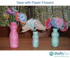 These vases were made from empty drinkable yogurt containers.  Any size container works well.  The flowers are made from tissue paper and coffee filters.
