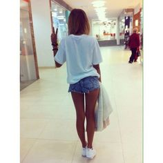 White t shirt and jean shorts.