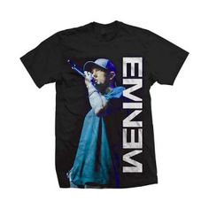 Eminem On The Mic Mens Tee - Go Berzerk in this officially licensed Eminem On The Mic Mens T-Shirt Size Medium. This product is a black t-shirt with a vertical Eminem Logo and a photo of the rapper at the mic. This shirt is 100% Cotton.