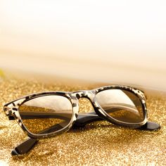 The hypnotic Carrera by Jimmy Choo sunglasses available in black and gold leopard print. Camouflage for the animalier.
