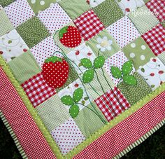 Berries on a quilt - another ready-made for purchase, but could be made. Great colors and patterns and the hand-stitching really adds to this one.