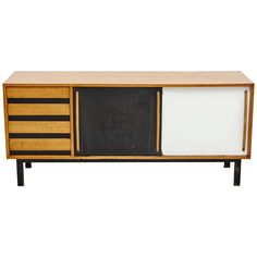 For Sale on - Sideboard designed by Charlotte Perriand, circa Edited by Steph Simon, France. Steel base, wood structure and grips, lacquered sliding doors. Decor, Furniture, Wood, Tv Console, Ikea, Home Decor, Ikea Tv Console, Storage, Sideboard Designs