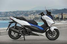 Honda Forza 125 – first UK road test Honda Bikes, Honda Motorcycles, Electric Bike Kits, Cool Cars, Vehicles, Scooters, Biking, Rain, Sport