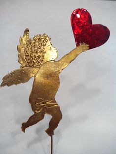 A romantic sculpture of an angel holding a red enameled heart. x inches A lost wax technique bronze sculpture of an angel holding a bronze heart painted with red enamel color. Sculpture Art, Sculptures, Valentine Day Gifts, Valentines, Studio Art, Art Object, Art Studios, Mosaic, Arch