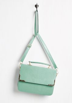 Refine your entire look in seconds, simply by sporting this chic mint satchel! Polished to goodness with its rectangular shape, gold metal-edged flap, and matching hardware, this vegan faux-leather shoulderbag shows that classy style is right around the corner!