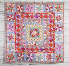 "It may be named after an opulent porcelain design, but there's nothing delicate about the dazzling Imari Plate Quilt Kit from Kaffe Fassett! You'll receive gorgeous Kaffe Fassett fabric and a pattern to sew this stunning quilt top, which features a unique center motif sure to inspire endless ""oohs and ahhs"". Get yours today, and infuse your favorite room with vivid color and sensational style!"