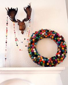 pom pom wreath via @cozy little cave blog- SO stinkin cute