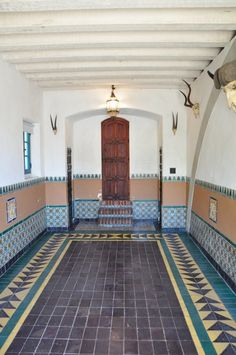 Casa de Herrero Monticetio Calif Can you believe this gorgeous room is the garage? The dark tile was used to hide oil