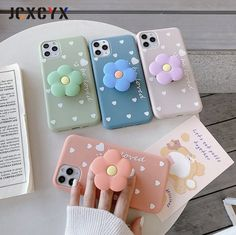 3D Luxury cute cartoon Flower Soft silicone phone case for iPhone iPhone Case and Finger Grip Protect your phone in style with one of these cartoon design iPhone cases. The cases include a finger grip/stand so it makes it easier to hold your phone. The stand is also incredibly handy for watching media on the go. Stocked in the UK and ready to send. Kawaii Phone Case, Girly Phone Cases, Pretty Iphone Cases, Cell Phone Covers, 3d Iphone Cases, Cartoon Flowers, Aesthetic Phone Case, Coque Iphone, Iphone Phone