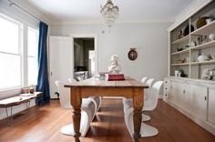 farmhouse table with mod chairs, love the bench and the giant built-in china cabinet