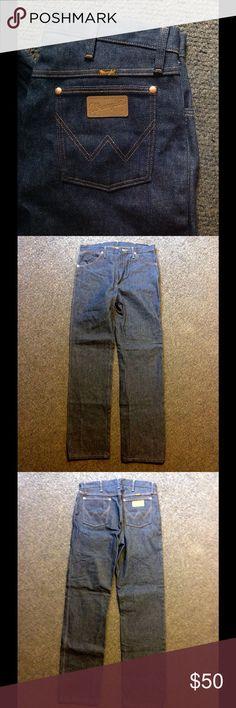 Vintage 70s 80s Wrangler Men's Jeans 33 X 34 Great pair of vintage Wrangler Jeans. 100% cotton - marked 33 X 34. Stiff and dark denim - seem unworn. Wrangler Jeans