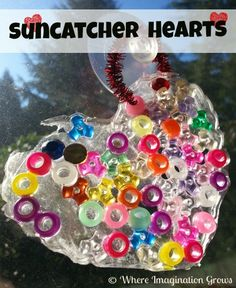 these suncatcher glue hearts are so easy to make & look so cute
