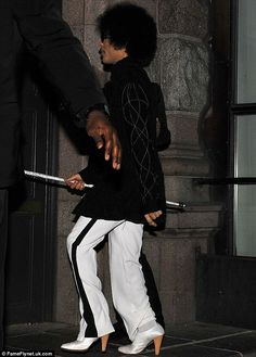 The guard trying to protect him & his shadow . Glad to see him stepping out in his heels.