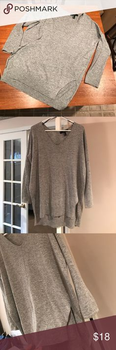 Long Grey Sweater Long grey sweater perfect to pair with leggings and boots! Very soft and warm and will be a great addition to your closet for fall! Worn a couple times and in great condition! Forever 21 Tops Tunics