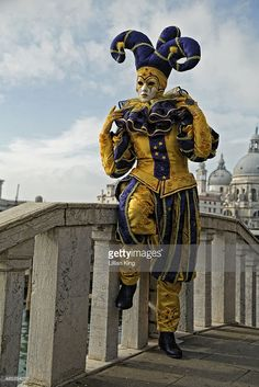 Taken at the Venice Carnival the jester on the bridge Sigh's with the Santa Maria della Salute in the background