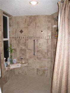 Handicapped shower does not have to be boring. This roll-in shower will serve the homeowners for years to come.  Windows are tinted but operable.