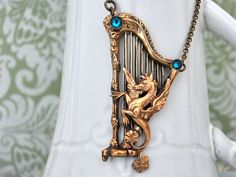 THE ANCIENT TIMES antiqued brass harp and Pegasus with Swarovski zircon color rhinestones on Etsy, 14868,42Ft