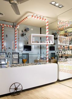 What looks like a traditional gelateria from the outside, is a Roald Dahl-esque fantasy-world within; gauges, tubes and taps heightening the sense of theatre and playfulness. #RetailDesign #Barcelona