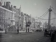 Old Dublin, O'Connell Street around 1900 looking south. Most of the buildings were totally destroyed during the 1916 Rising. Some never rebuilt including what looks like a church on the left hand side of the street.