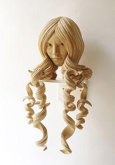 wood/head of a girl, love the hair