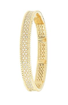 The Perlée bracelet by Van Cleef & Arpels.  After the success of its previous rose gold model, the Place Vendôme jeweler goes for gold with a slimline bracelet encrusted with a honeycomb of snow-cut diamonds.