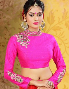 Magenta raw silk readymade designer blouse with exquisite work and Bandhgala Pattern. For more visit our site.